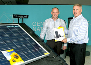 Blue Build Energy's Ewan Melvin and Gavin Logan in front of an ANTARIS SOLAR PV panel.